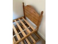 Single bed with stored guest bed under