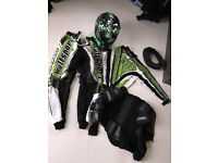 Motocross neckbrace, helmet, trousers and tshirt
