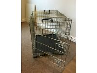 Small collapsible dog crate/cage. Excellent condition.
