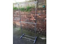 Adjustable height clothes rail