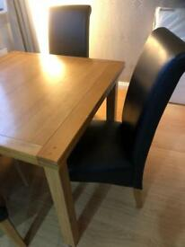 Harvey's extending dining table and chairs.