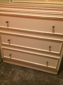 White double wardrobe with top box and chest of drawers with a mirror