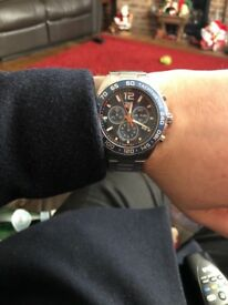 Selling tag heir watch f1 couple months old