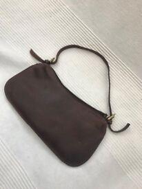 Small brown leather handbag