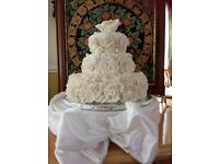 Three tier,fake wedding cake,real decorative icing,would sit on top of a 14 inch cake. Ivory colour