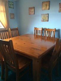 Dining room table and 8 chairs.