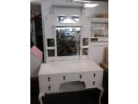 Lovely shabby chic dressing table with an old ornate mirror