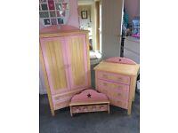 Wardrobe, Chest of Drawers & Shelf/Coat rack. Solid wood in natural colour with pink trim.