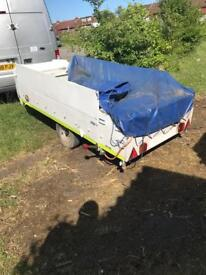 Converted trailer tent