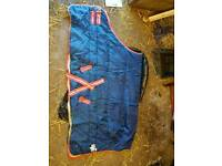 Various stable and turnout rugs