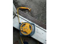Small garden hose with reel and nozzle