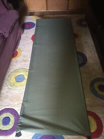 Traditional camp bed in olive green - excellent condition, £9 ONO. Collect from Knaphill, Surrey