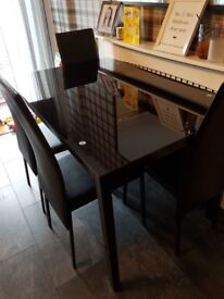 Black glass dining table and 4 high back dining chairs for sale £65