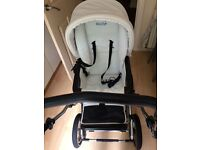 White and blue babystyle prestige pram converts into pushchair