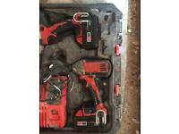 Milwaukee impact driver and drill driver