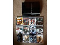 PS3 with 11 games and controller.