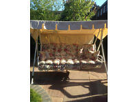 3 Seater Garden Swing with beige hood & 5 floral cushions