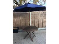 Foldable wooden patio table and parasol