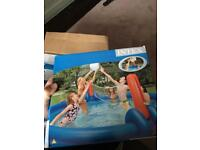Intex volly ball and basket ball set, fits on the side off swimming pool.