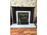 Fireplace surround, hearth and electric fire