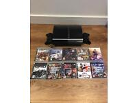 PS3 console with 10 games and 2 controllers
