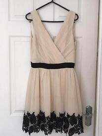 Size 12 cream and black dress