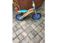 Children's wooden balance bike.