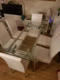 John Lewis EXTENDING SOLID GLASS DINNING TABLE