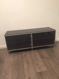 Dark brown Ikea Unit with 2 glass doors & shelving. Potential Tv unit.