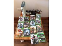 xbox 360 white. comes with a selection of games!