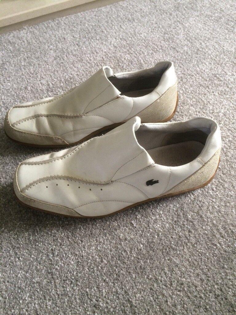 Size 8 men's Lacoste White shoes.