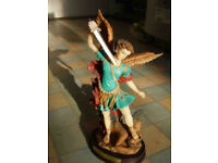 Archangel Michael resin statue on wooden base with nameplate