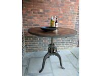 Vintage industrial rustic crank dining/bar table. 1m x 1m circular. Iron base wooden top.