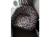 Zebra print tub chair. Excellant condition, stylish and eye catching.