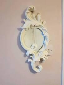 Ornate round mirror