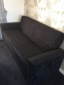 Black velvet sofa settee. Nearly new condition. Opens up for storage and becomes a flat bed.