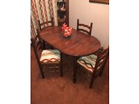 Extending wood dining table & 4 chairs