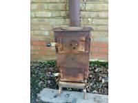 Heavy duty log burner with long chimley.