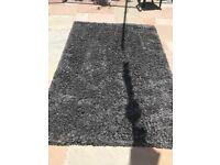 Large grey charcoal rug