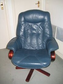 A blue leather extending and revolving armchair in excellent condition