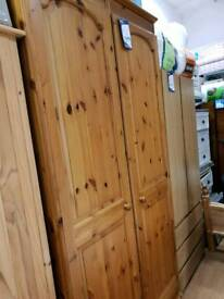 Tall solid pine wardrobe shelved one side with mirror hanging other side