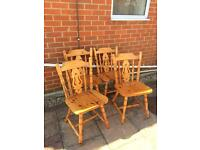 4 solid pine dining chairs