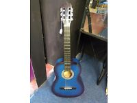 Blue classical acoustic guitar