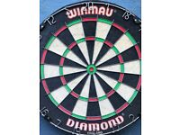 Winmau diamond dartboard. Like new as hardly used. Will come with darts