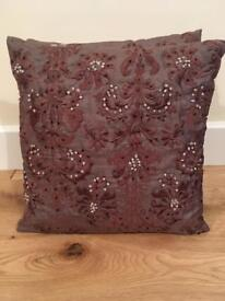 Stunning pair of 100% silk cushions with brown embroidery and cream beads. 30 cms squared.