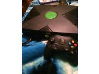 For sale a original Xbox with controller and ten games