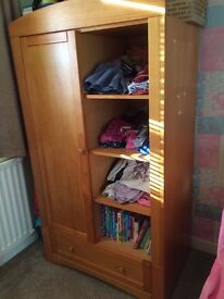Cot bed with matching wardrobe and change table.