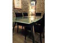 Glass extending dining table 7x3ft with silver insert seats 8 people