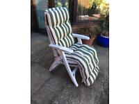 Reclining garden chair- white with striped cushion.