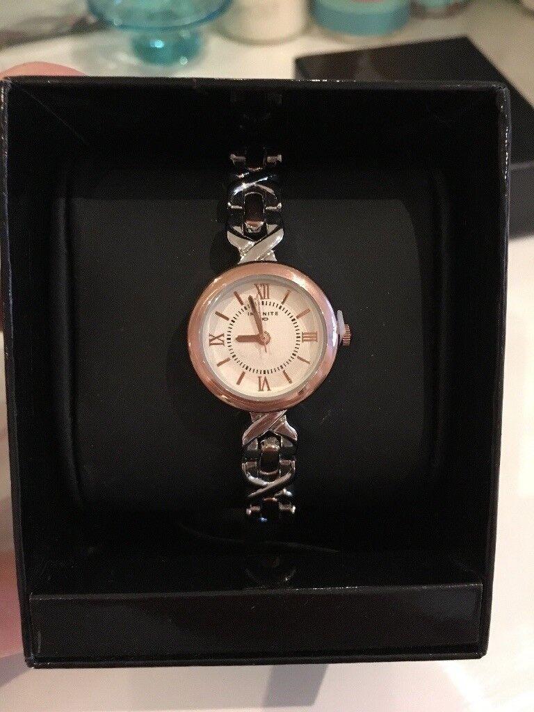 BNIB Infinite Ladies Silver And Rose Gold Link Wrist Watch